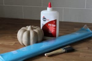 decorate a teal pumpkin with tissue paper