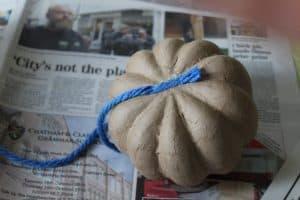wrap teal pumpkin with wool