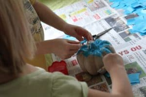 cover teal pumpkin with tissue paper
