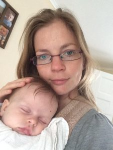 baby sleeping in sling
