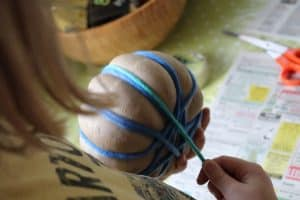 wrapping pumpkin with teal wool