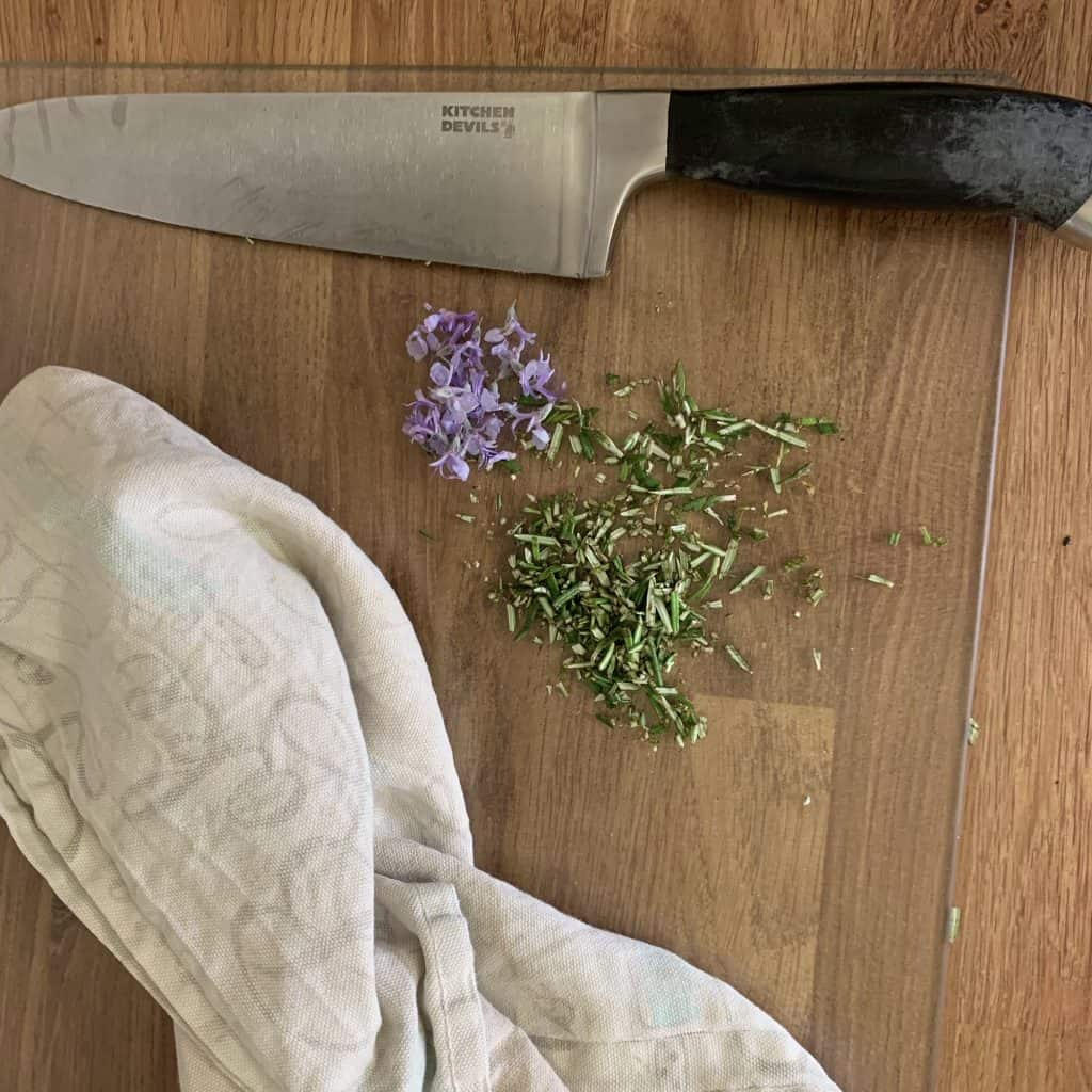 rosemary flowers and chopped leaves