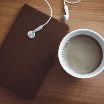 earbuds, coffee and notebook